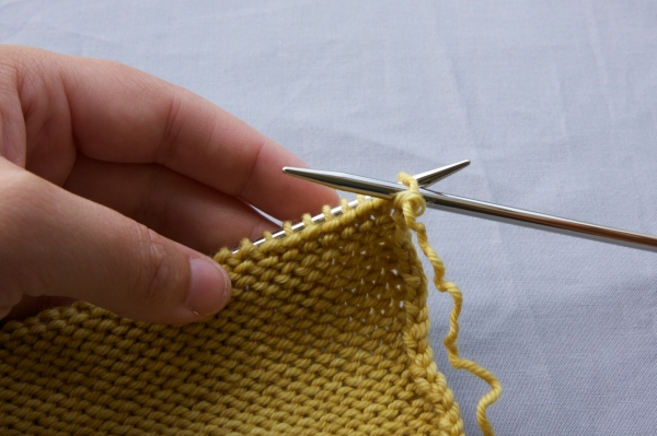 Insert your needle, ready to work the next stitch (in this case it's a purl)