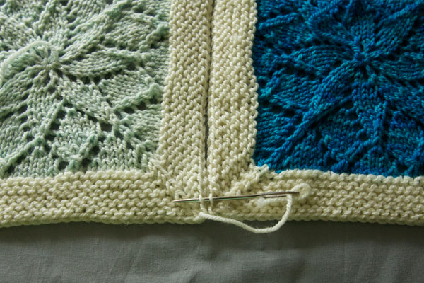 two blanket squares being seamed together