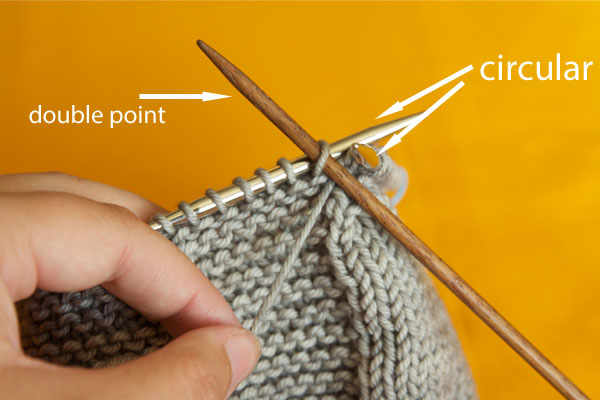 Ignoring your right hand needle you will instead work to the second marker with your DPN