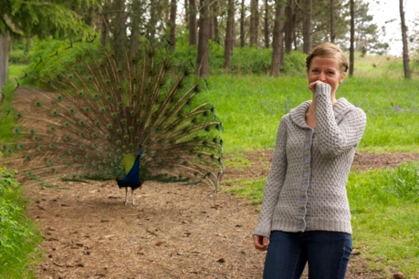 Jane trying to model through the peacock in the background.