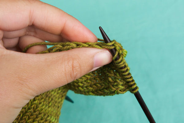 Put your needle through the stitch from front (RS) to back