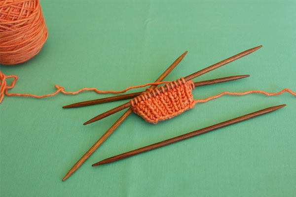 All sts are now on the larger needles