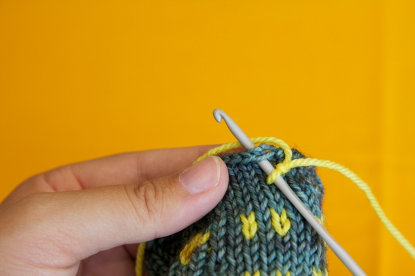 2. Put your hook through the top of stitch 4
