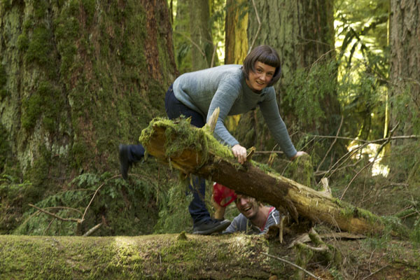 Em helping Jordan after a fall in the woods