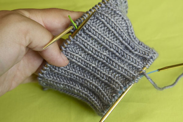 Un-picked provisional cast on stitches are now on a spare needle