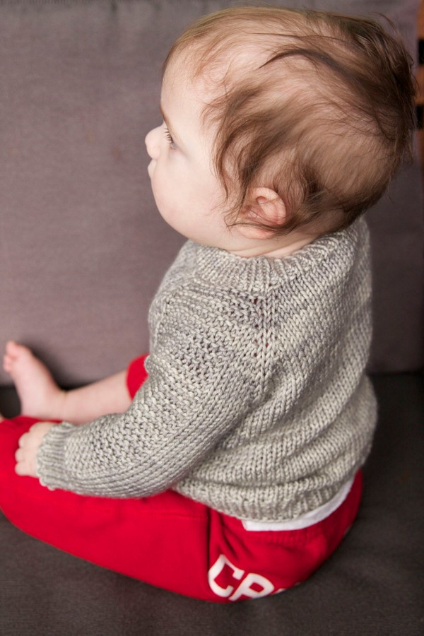 Bodhi is rocking a Flax sweater in Sweet Fiber Merino Twist Worsted in 'Paper Birch'