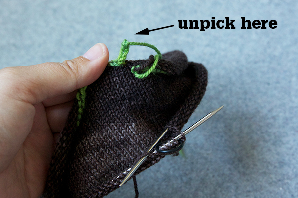 Step 1: Unpick the knot in your crochet chain and start unraveling