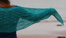 The Estuary Shawl (a free pattern) features two different wave lace patterns.