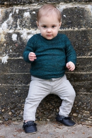 baby in deep teal sweater and grey leggings
