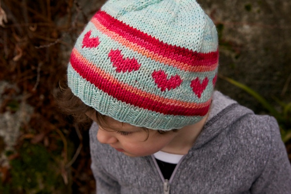 Hunter in her i heart rainbows hat, made a couple of Valentines ago