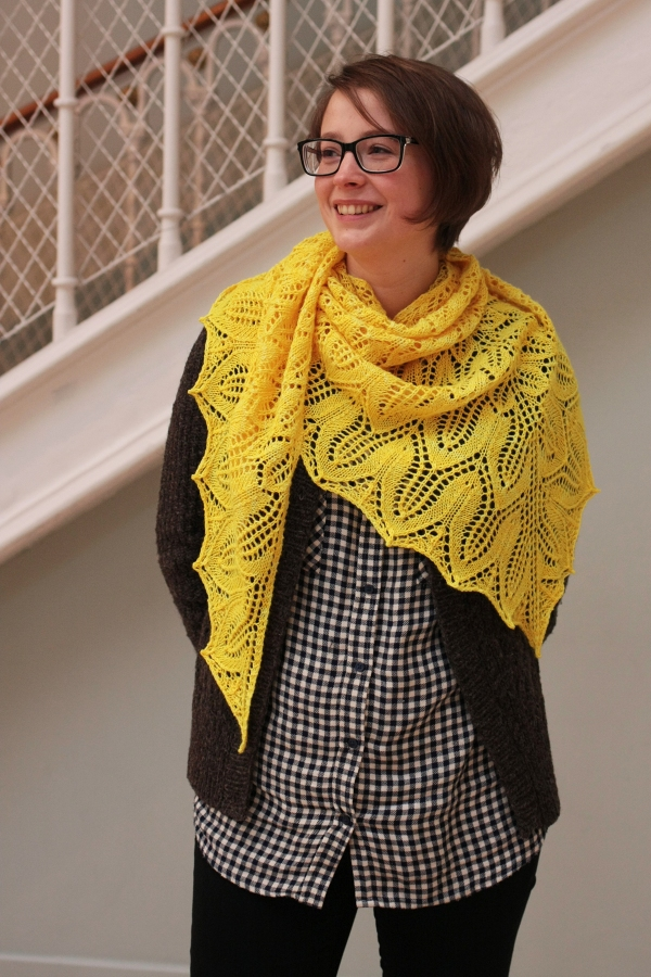 Nina is taking in the Natural History Museum in her lovely Sunflower Shawl, wrapped casually off center
