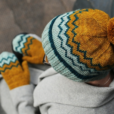 view down upon a person in a colourwork hat and mittens