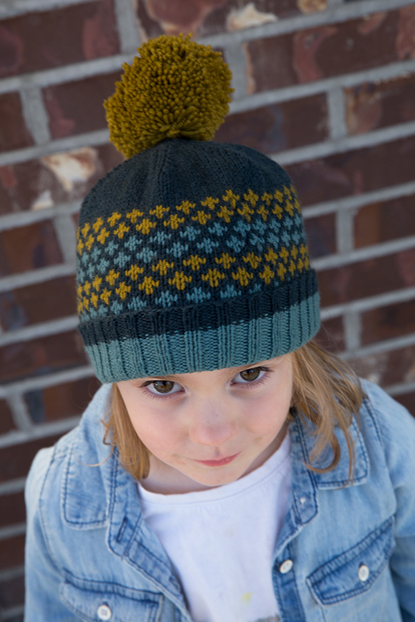 child wearing a colourwork hat