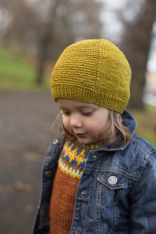 toddler in yellow beanie with garter panel