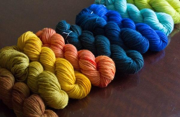 a rainbow of skeins of handspun yarn