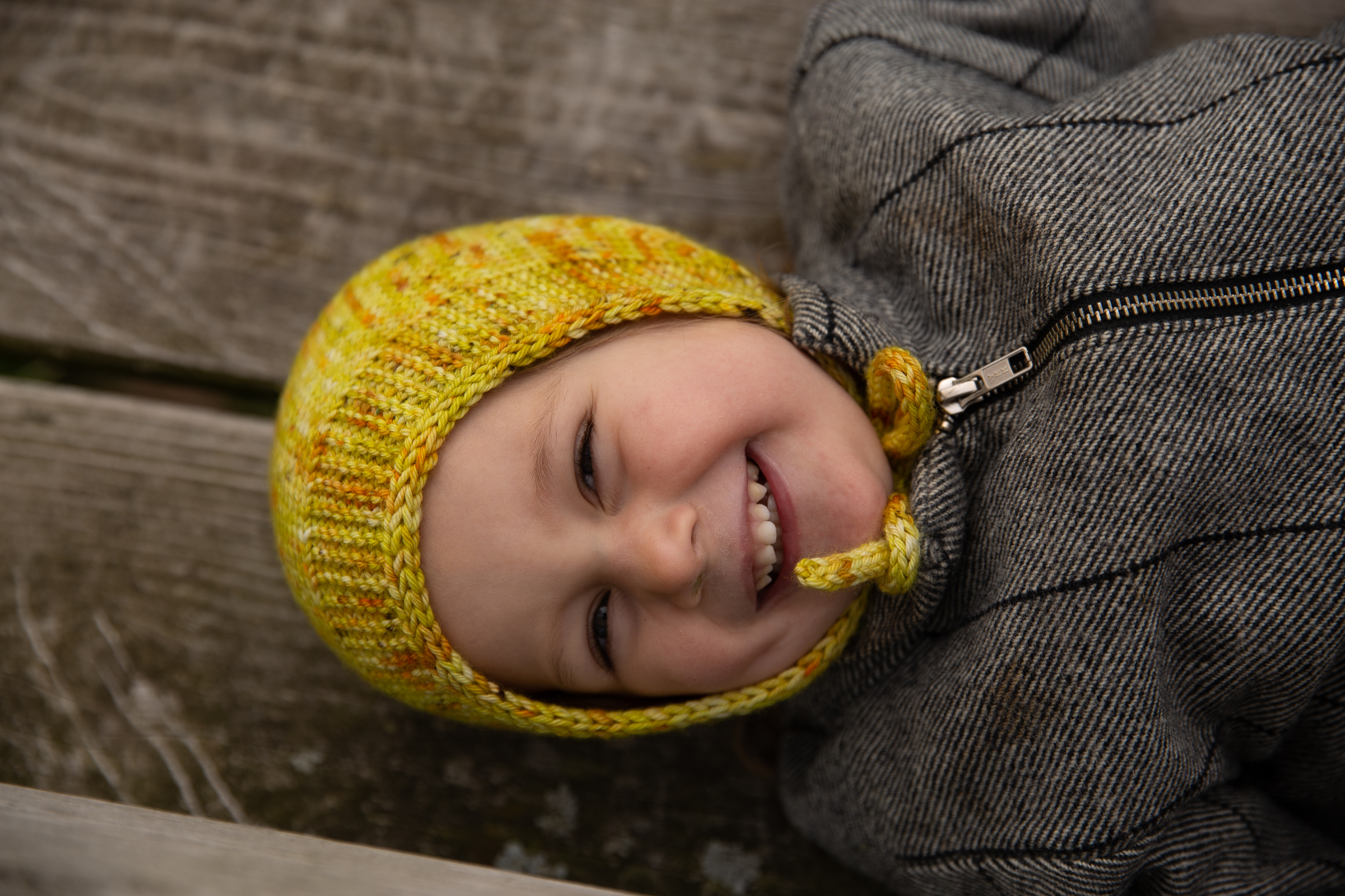 smiling child in bonnet