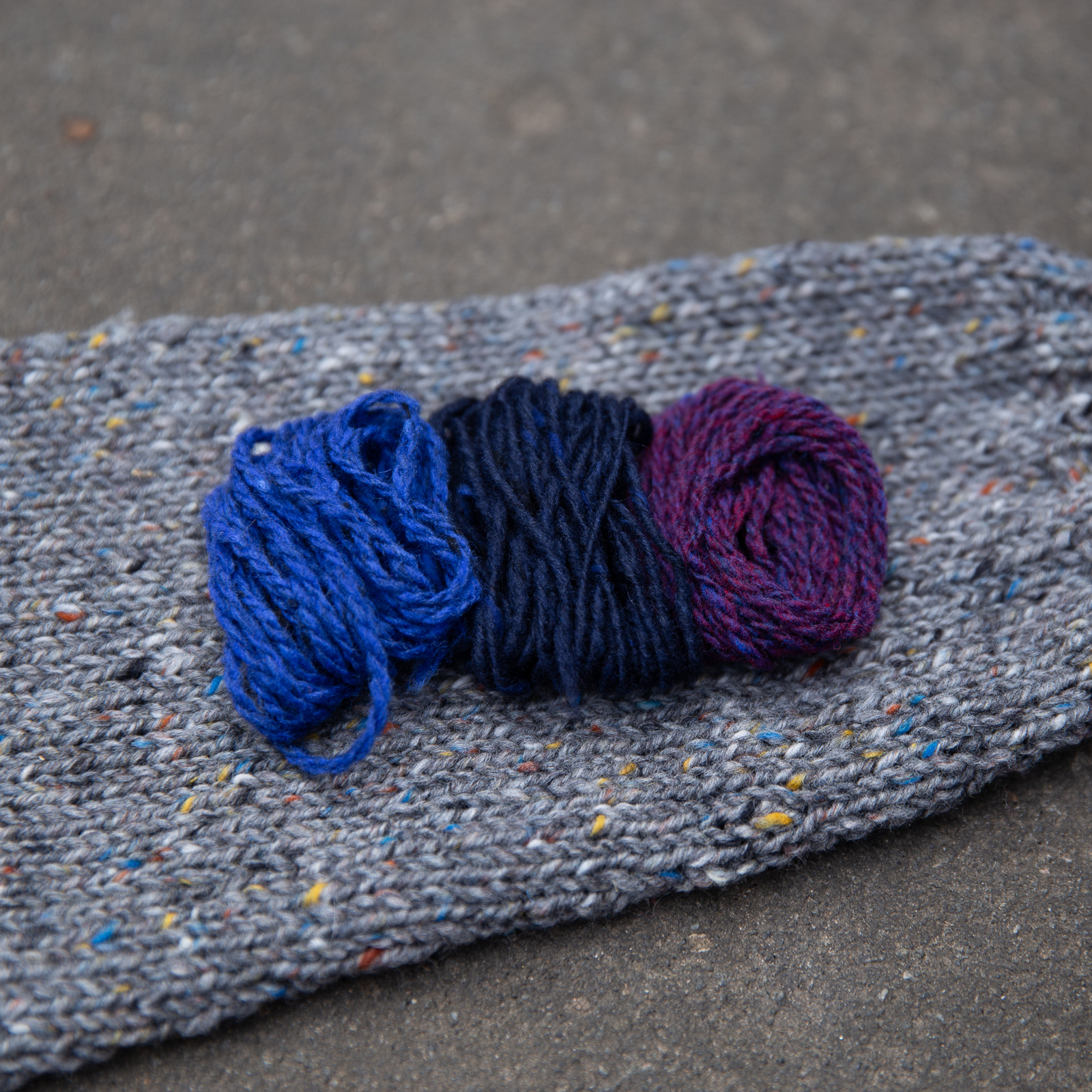 yarn palette of cobalt blue, navy blue, purple