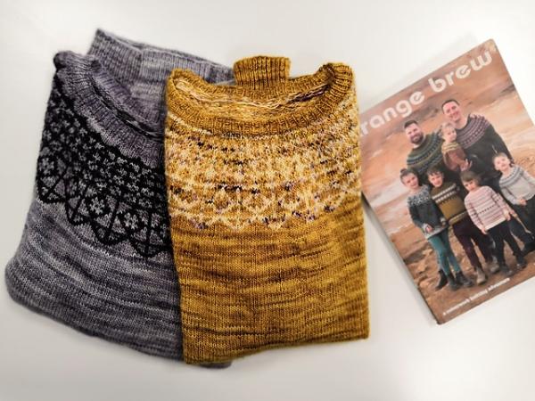 Yellow sweater, grey sweater, and Strange Brew book