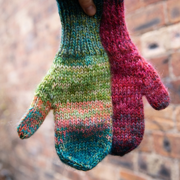 a mismatched pair of marled mittens