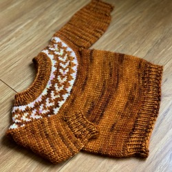 tiny brown colourwork yoke with white pattern