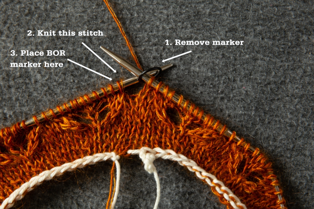 knitting project in progress, with a stitch marker