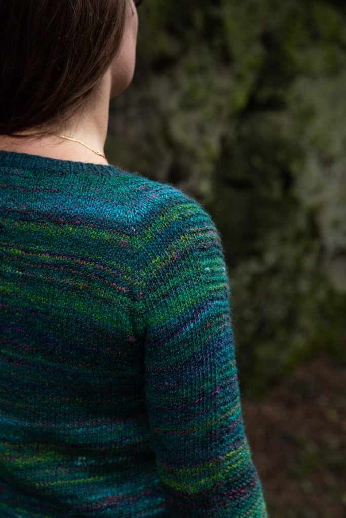 shoulder detail of a green and teal handspun sweater
