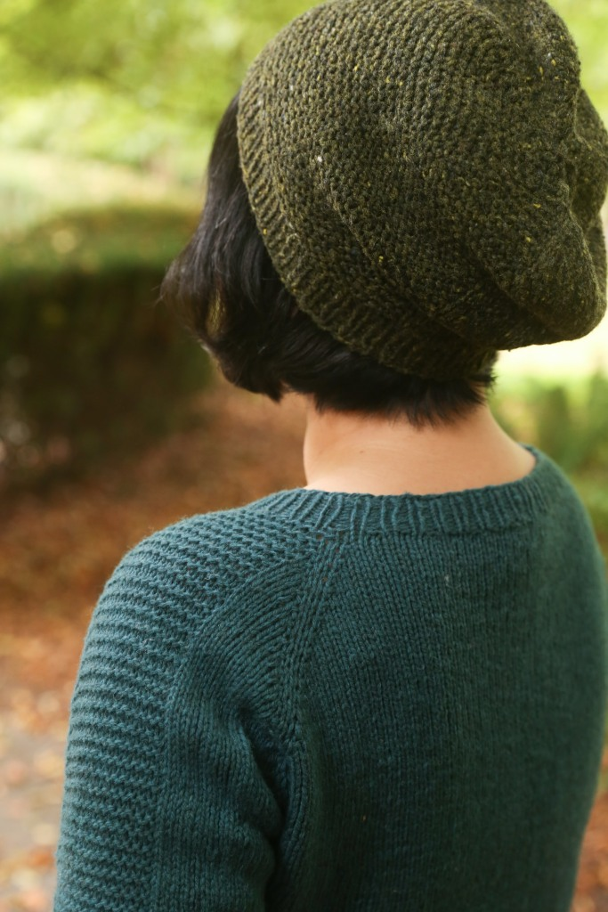 A woman in a hand knit sweater and hat