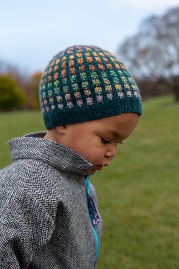 toddler in colourwork hat