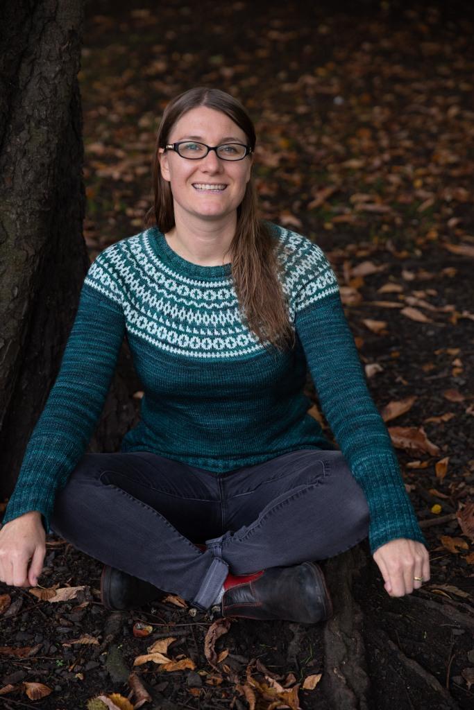 a woman in a colourwork yoke sweater