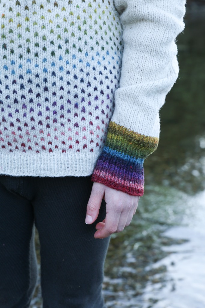 a close up of the sleeve of a colourwork sweater