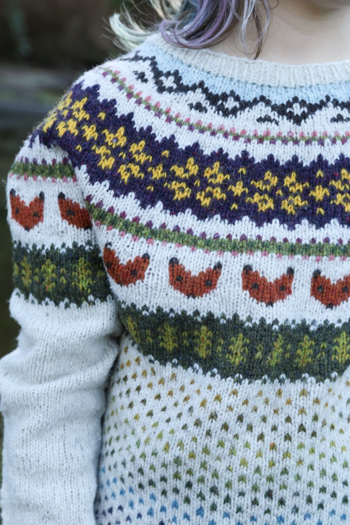 a child in a colourwork sweater