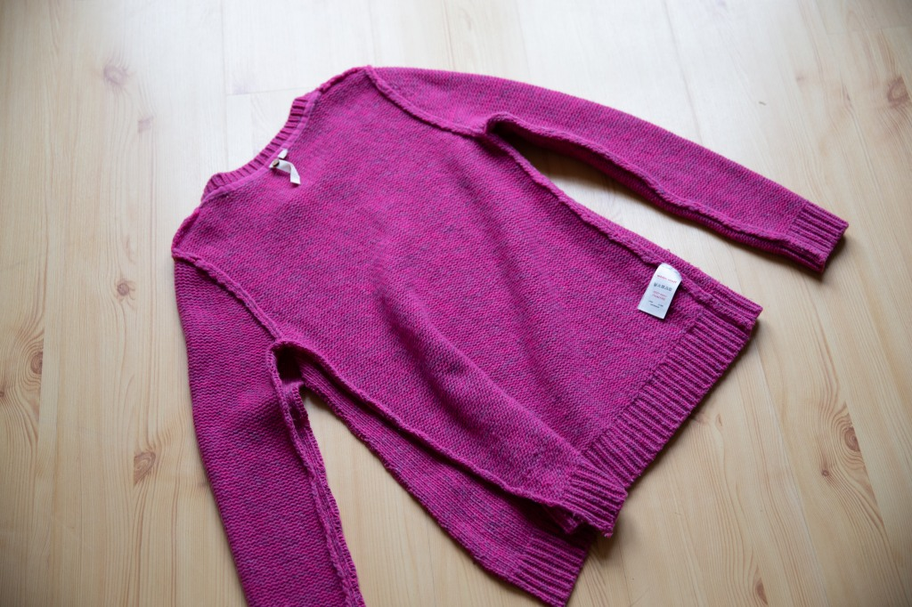 an inside-out sweater with one seam unpicked