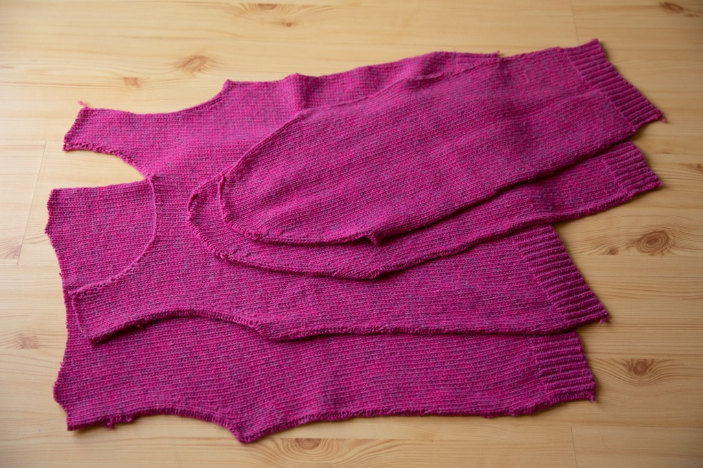 a pink sweater taken to pieces