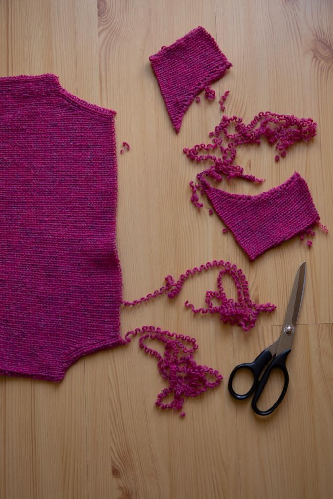 unpicking a sweater back to yarn