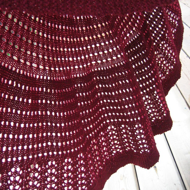 a round lacy blanket